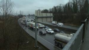 Drivers asked to avoid Highway 1 in Burnaby after truck flips causing major delays