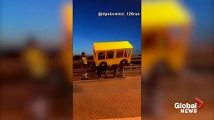 A group of Russians dressed up as a bus get busted while crossing a vehicle-only bridge