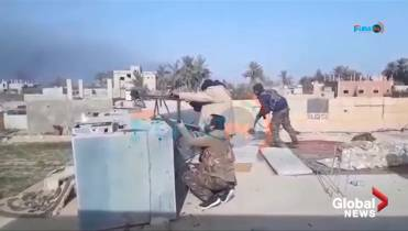 Cornered in Syrian village, ISIS fighters try to fight off