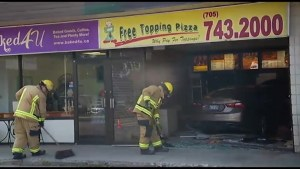 Car crashes into pizza restaurant in Peterborough