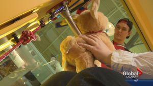 Calgary Hitmen build teddy bears for annual Teddy Bear Toss