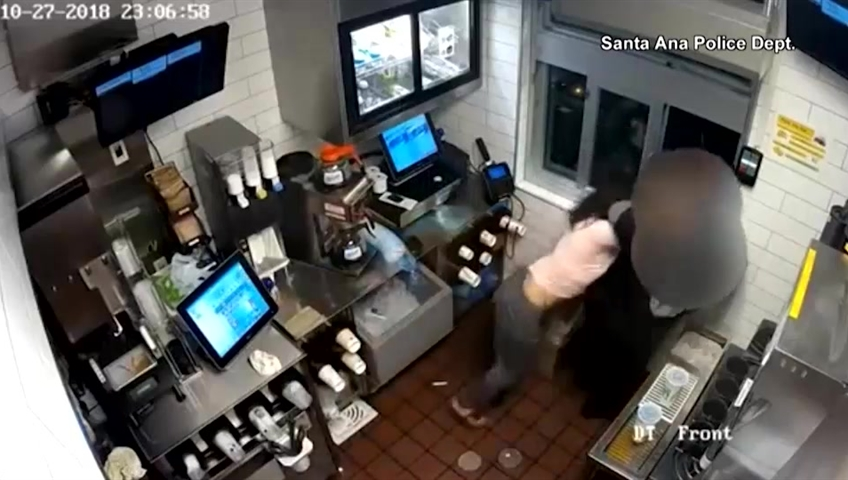 Shocking moment a McDonald's manager is beaten up over missing ketchup