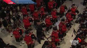 'Amazing Grace' fills the hall in honour of Const. Woodall