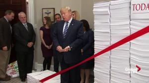 In odd ribbon cutting ceremony, Trump promises to reduce regulations