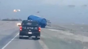 Powerful winds send grain silo rolling down Alberta highway
