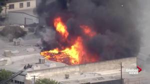 Crews battle warehouse fire in downtown Modesto, California