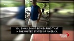 Officer who took no action as man harassed woman in a Puerto Rican flag shirt is reassigned