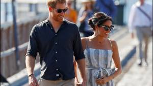 Meghan Markle cradles stomach as she rejoins Prince Harry on Fraser Island