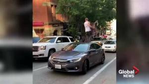 Man damages vehicle, uses sunroof as weapon in Seattle