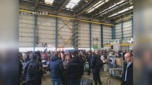 Security holds Brussels bound passengers in airport hangar