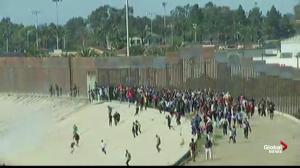Migrants approach U.S. border from Mexico