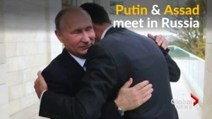Bashar al-Assad hugs it out with Vladimir Putin at the Kremlin