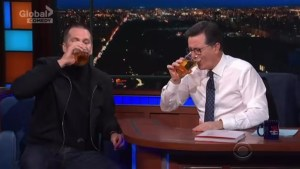 Stephen Colbert chugs a beer with Tom Brady