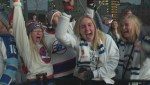 Fans at the Winnipeg Whiteout Street Party cheer as Jets score