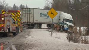 Truck stuck in a ditch on Ontario highway during ice storm