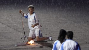 Former Paralympian drops torch, rises again to applause