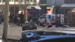 Injured seen laying on street after a van plows into crowd in Barcelona