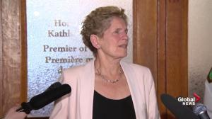 Wynne says Ontario QP won't be suspended: 'we have to continue'