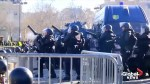 Paris' iconic Champs Elysees transformed into war zone as riot police clash with protesters in Paris