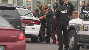 Global cameraman follows police as they leave conference on downtown safety to assist in arrest