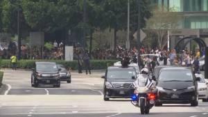 Motorcade believed to be carrying Kim Jong Un drives through Singapore