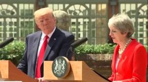 Trump criticizes May, meets the Queen for tea