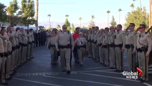 Las Vegas police officers escort casket of cop who was killed during concert shooting