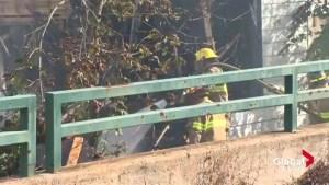 Crews still battling hot spots in stubborn Bridgewater fire