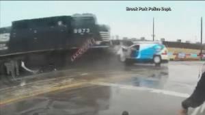 Caught on Camera: Man escapes van seconds before train demolishes vehicle (00:30)