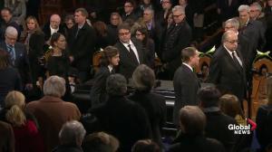 Celine Dion, family, friends of René Angélil walk his casket out of Notre-Dame Basilica