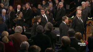 Celine Dion, family, friends of René Angélil walk his casket out of Notre-Dame Basilica