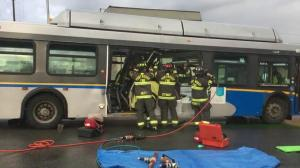 Passengers hurt, woman stuck after truck hits Port Moody transit bus