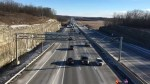 Rolling blockade of protesters slows traffic on Hwy. 401