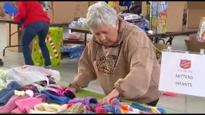Volunteers prepare toys for the Salvation Army Christmas Hamper Program