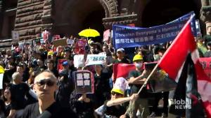 Protesters face off at rally for Hong Kong in Toronto