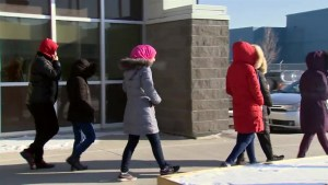 Newcomers adjust to cold, Canadian weather