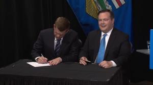 Brian Jean and Jason Kenney sign unity agreement