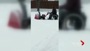 Monctonian doesn't let wheelchair stop him from using snow blower to clear his driveway