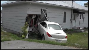 Car slams into house in Campbellford