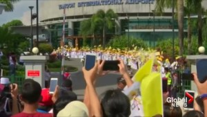 Pope Francis receives warm welcome on trip to Myanmar