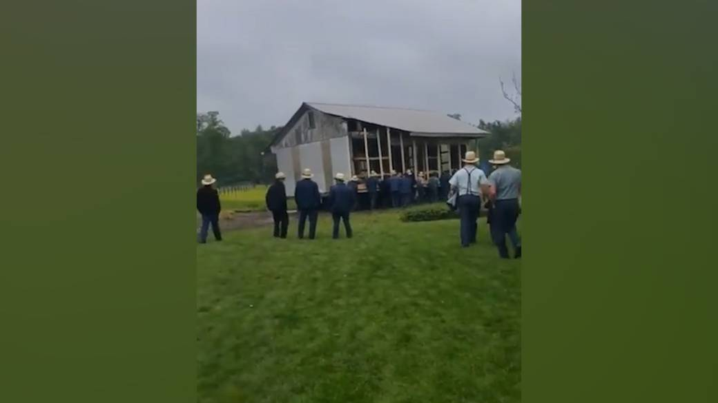 Dozens of men from Ohio Amish community come together to move building by hand