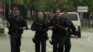 Police seen running to shooting scene after shots fired in Munich, Germany