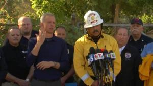 Firefighters preparing to battle increasing winds in wildfire control