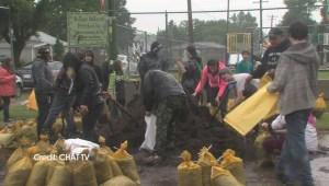 Medicine Hat volunteers fill sandbags