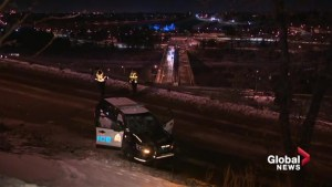 Edmonton police vehicle rolls down embankment during pursuit