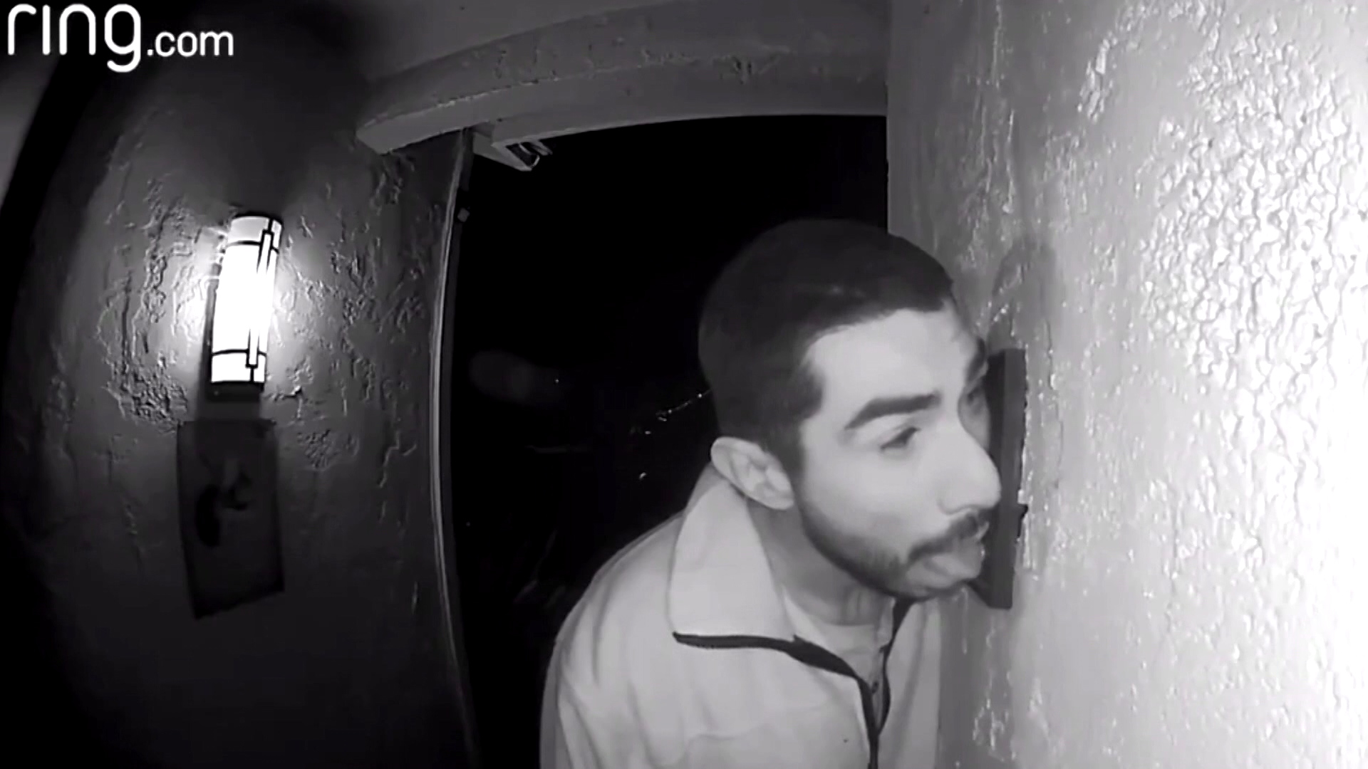 Camera catches man licking doorbell