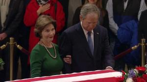 George W. Bush revisits his father at the Capitol building