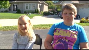 Two kids set up Cops love Lemonade stand in Cobourg