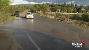 Water flooding Casorso Road near Swamp Road in Kelowna