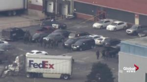 Police SWAT teams search Henry Pratt Co. in Aurora, IL after shooting